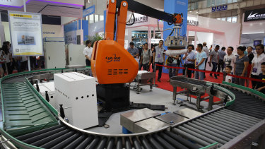 An industrial robot demonstration in Beijing. Industrial robots are among the Chinese products targeted for tariffs.