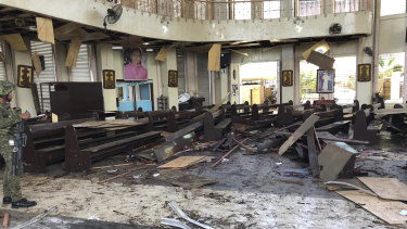 A soldier views the site inside a Roman Catholic cathedral in Jolo, the capital of Sulu province in the southern Philippines after two bombs exploded on Sunday.