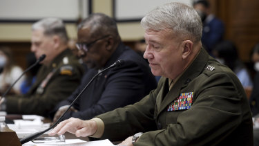 From left, US General Mark Milley, Secretary of Defence Lloyd Austin and Marine Corps General Kenneth McKenzie testify before the House Armed Services Committee on Wednesday.