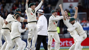 Australia's players celebrate after winning the fourth test and retaining the Ashes.