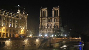 Notre Dame Cathedral is lit up in Paris.