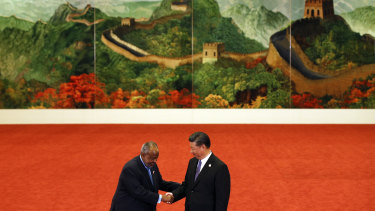 Djibouti's President Ismail Omar Guelleh, left, shakes hands with Chinese President Xi Jinping during the Forum on China-Africa Cooperation in Beijing last year.