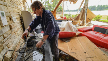 Eric Ehlenberger goes through his damaged home in New Orleans on Wednesday following a storm that swamped the city.