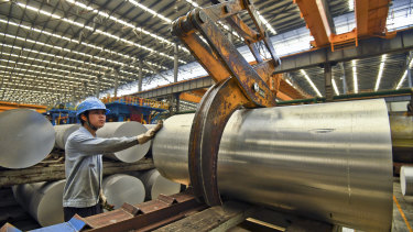 A worker transfers an aluminium product at a factory in Nanning in south China's Guangxi Zhuang Autonomous Region.