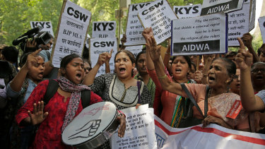 Indian students and activists participate in a protest against recent cases of rape in the country.
