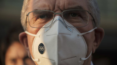 IOC President Thomas Bach wears a mask in Tokyo late last year.
