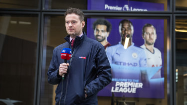 A sky sports presenter speaks to camera outside the Premier League headquarters on March 19 as clubs and officials met to discuss plans for the remainder of the season.