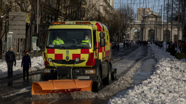 A truck mounted snow blower works at Calle de Alcala, Madrid, on Sunday.