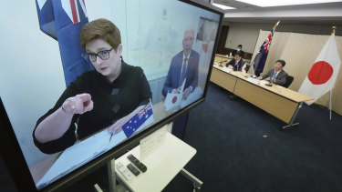 Foreign Minister Marise Payne and Defence Minister Peter Dutton, on screen, attend a video conference with Japan's Foreign Minister Toshimitsu Motegi and Defence Minister Nobuo Kishi on Wednesday.