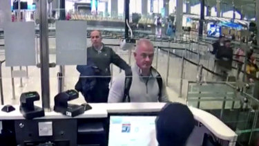 Security camera video shows Michael Taylor, centre, and George-Antoine Zayek at passport control at Istanbul Airport in Turkey in December 2019.