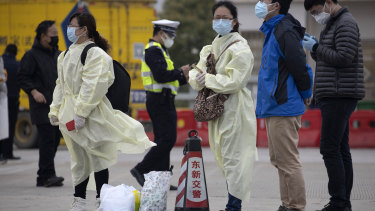 Residents of China wearing protective gear, where they are tentatively lifting restrictions.