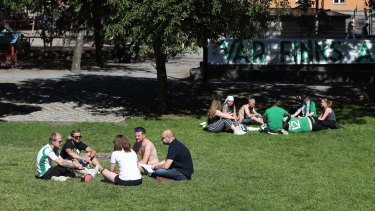 Fans of Hammarby football club socialise in a Stockholm park before a match on Sunday.