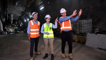 Transport Minister Andrew Constance, Premier Gladys Berejiklian and Transport for NSW secretary Rodd Staples inspect the station site.