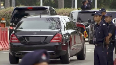 A large Mercedes limousine with a North Korean flag believed to be carrying North Korean leader Kim Jong-un is driven on a street in Singapore last year.