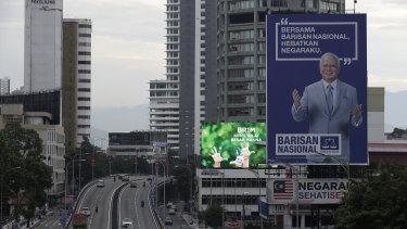 Fallen idol: A giant campaign billboard of defeated incumbent Najib Razak looms over the highways of Kuala Lumpur.