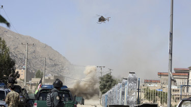 An MD 530F military helicopter targets a house where suspected attackers are hiding in Kabul, Afghanistan, on  August 21, 2018.