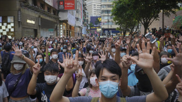 Hongkongers protest against new security laws in the former UK colony.