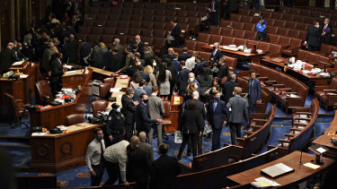 Members of Congress being evacuated from the House Chamber after Trump supporters breached the Capitol.