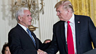 Mike Pence, seen here with Donald Trump, defended the administration's foreign policy under tough questioning from Dick Cheney.