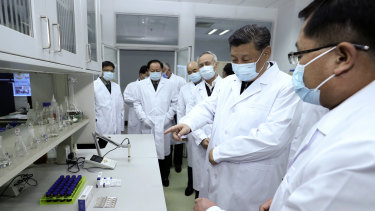 Chinese President Xi Jinping - on the job - talks to a medical staff members during his visit to the Academy of Military Medical Sciences in Beijing.