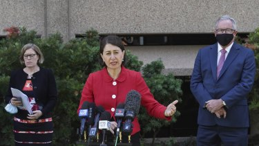 NSW Premier Gladys Berejiklian, with Chief Health Officer Kerry Chant and Health Minister Brad Hazzard, announce the easing of Sydney's lockdown restrictions for the Christmas period.
