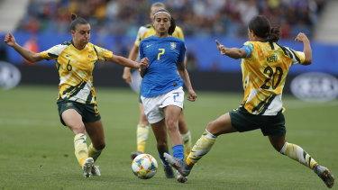 Chloe Logarzo and Sam Kerr pressure Brazil's Andressa Alves Da Silva during the win over the South American giants.