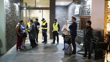 Residents evacuating the building on Friday night after receiving a letter from the building manager saying they had until 9pm to vacate the complex.
