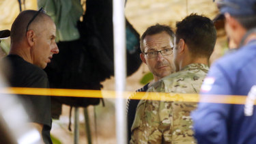 John Volanthen, center, talks to US personnel and Richard Stanton, left, in Mae Sai, Chiang Rai province, northern Thailand.