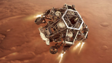 In an artist's rendering, the Perseverance rover fires up its descent stage engines as it nears the Martian surface.