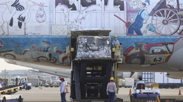 Workers unload a shipment of Pfizer vaccines from an aircraft at the Taoyuan International Airport in Taiwan.