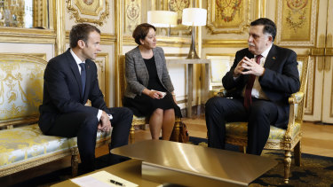 French President Emmanuel Macron (left) and Libyan Prime Minister Fayez Sarraj (right) met in Paris in May to discuss a roadmap to elections in an effort to bring order to Libya's political chaos, which is feeding Islamic militants and instability, and providing a corridor for African migration to Europe.