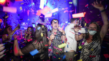 Londoners celebrated the end of restrictions at nightclubs and bars.