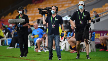 Broadcast personnel at Suncorp Stadium on Thursday night.