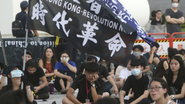 Protesters gather at Democracy Square in Taipei to mark the first anniversary of a mass rally in Hong Kong against the now-withdrawn extradition bill.