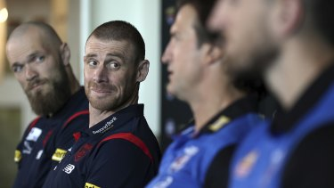 Demons coach Simon Goodwin looks on as Bulldogs counterpart Luke Beveridge speaks to the media on Friday.