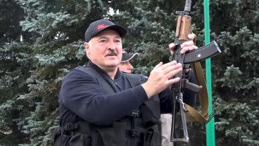 Belarus President Alexander Lukashenko armed with a Kalashnikov-type rifle near the Palace of Independence in Minsk, Belarus.