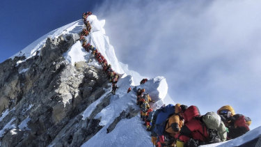 A photo of climbers lining up at the summit of Mount Everest in May 2019.