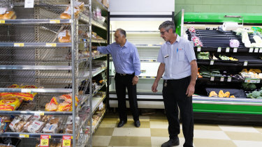 Small towns are also running out of stock due to coronavirus panic buying. Cobar IGA owner Robert Khan, left, and manager, Matt Carey.