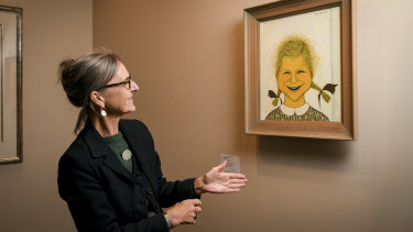 Charlotte Brack (daughter of artist John Brack) with her portrait.