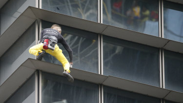"""French urban climber Alaine Robert, popularly known as """"Spiderman"""", climbs down after scaling the 47-Storey GT Tower Building."""
