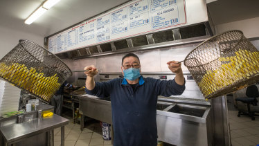 John Tang at Bulleen Fish and Chips prepares for the traditional Good Friday rush despite the coronavirus outbreak.