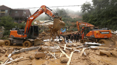 Rescue workers use heavy equipment to search for survivors in a collapsed house in Gapyeong, South Korea.