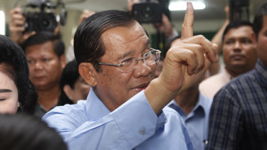 Cambodian Prime Minister Hun Sen shows off his inked finger after voting south-east of Phnom Penh on Sunday.