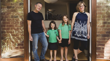 Canberra architect Robbie Gibson has invested into SolarShare, a community run solar farm. Mr Gibson is pictured with his wife Karin Gustavsson, and their children Nelly, 6, and Freya, 9.