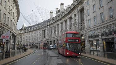 Buses on an empty Regent Street in London.