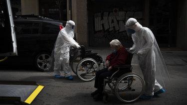 A nursing home resident displaying coronavirus symptoms is taken to hospital in Barcelona.