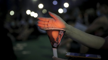 Activists defied bans to hold a candlelight vigil in Hong Kong.