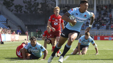 Started well: Israel Folau crosses for a try against the Sunwolves in Tokyo in round two.