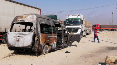 The destroyed minibus near an Iraqi army checkpoint south of Karbala, Iraq.