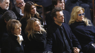 French late rocker Johnny Hallyday's former wives, actress Nathalie Baye, left, and singer Sylvie Vartan, right, and his children, David Hallyday and Laura Smet, 2nd left, attend his funeral.